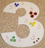Fun way to integrate number recognition into a preschool art project.