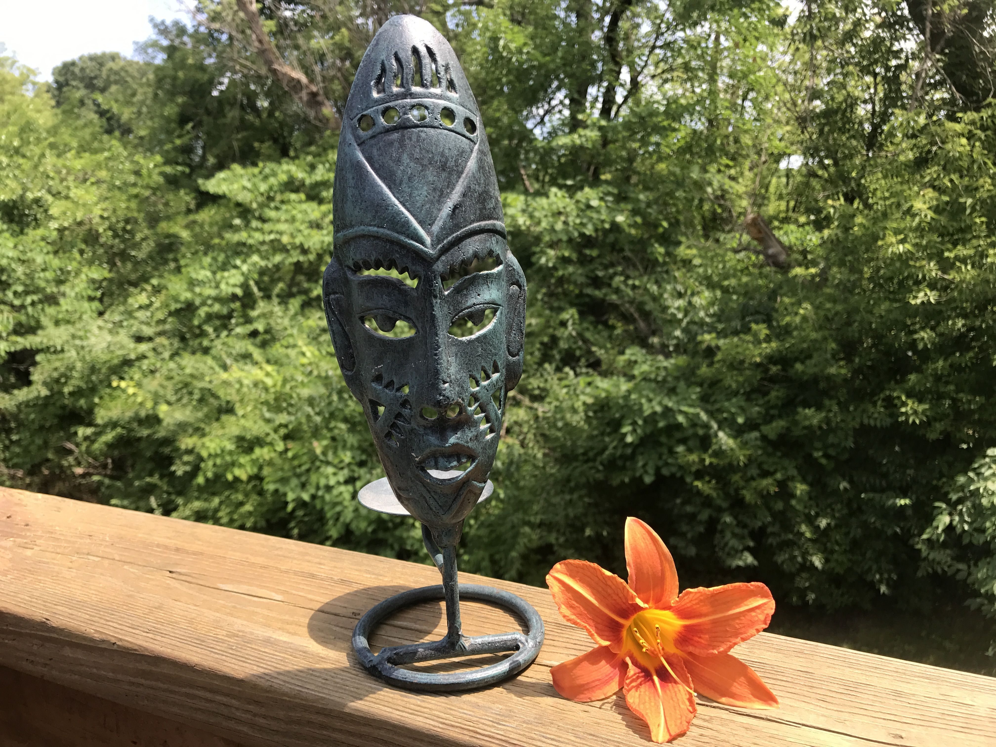 Vintage shabby black and turquoise metal tribal mask