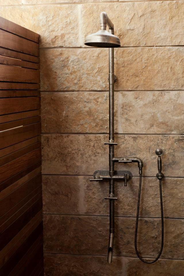 A Rugged Exposed Thermostatic Shower Set Lake Flato Architects Shower Plumbing Rustic Shower Industrial Style Bathroom