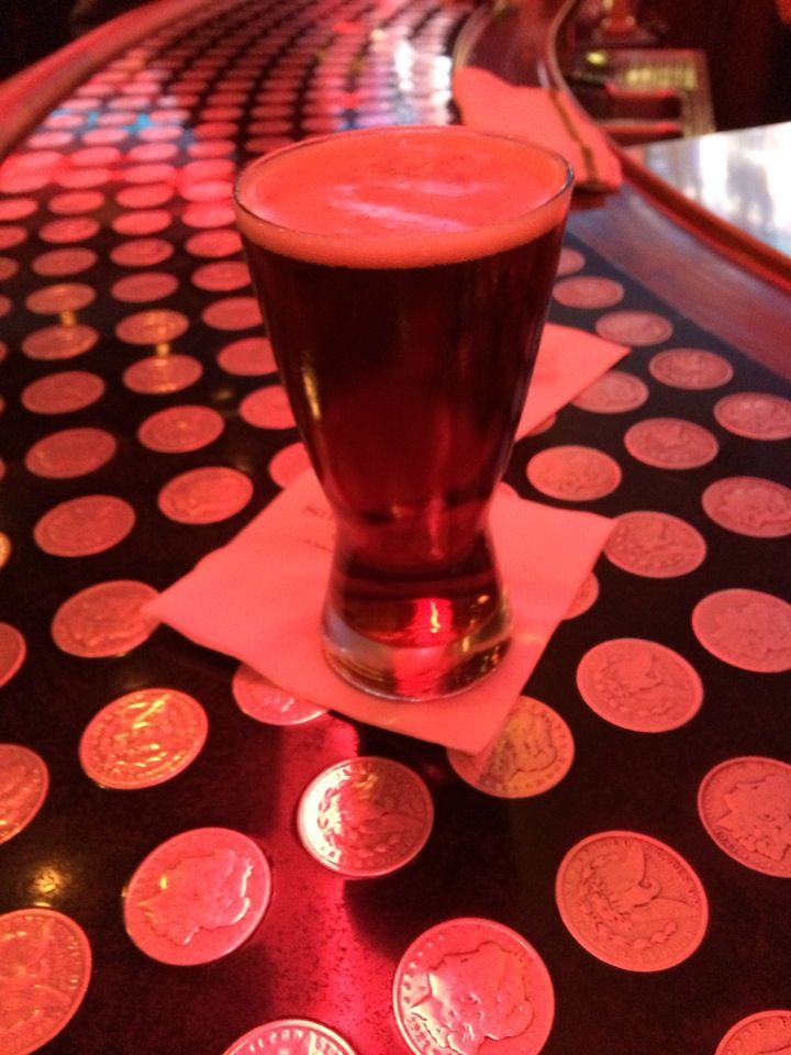The bar has hundreds of silver dollars embedded in it; good food, drink and wait staff.