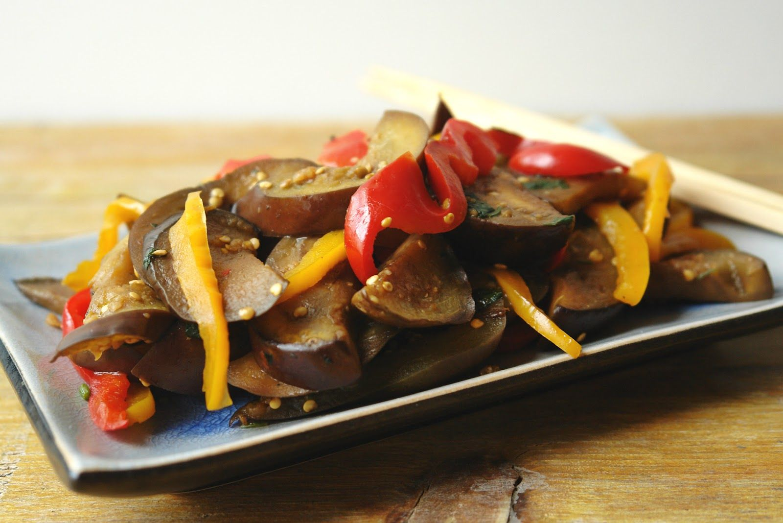 aubergines with red and yellow peppers