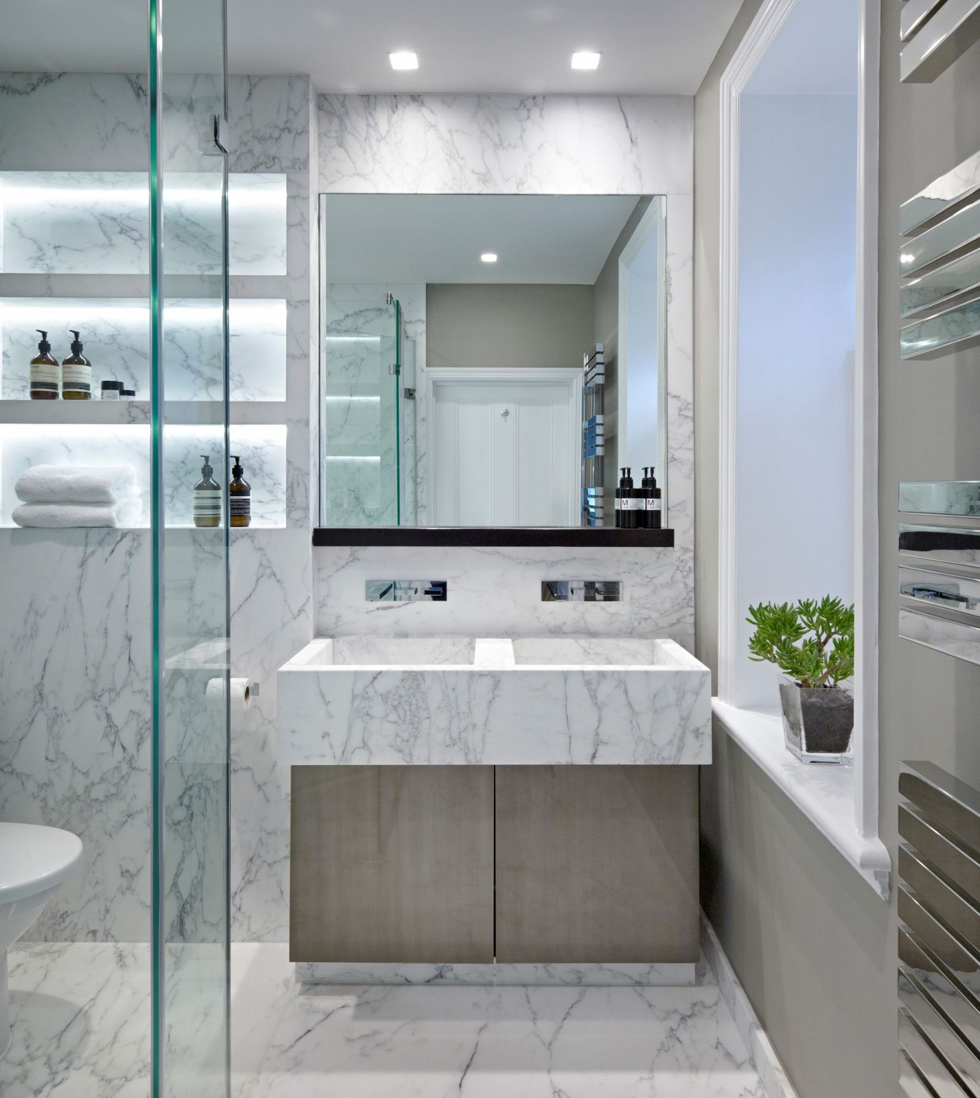 white marble bathroom in a home in yorkshire, uk designedfiona