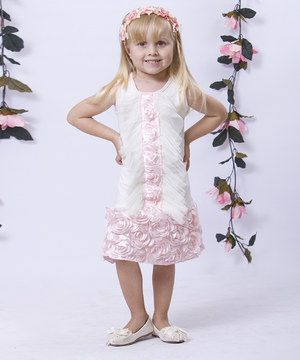 Flowers and fluttery ruffles play up a fun-loving look on this dress. Soft, stretchy polyester-blend fabric and allover ruffly roses offer effortless style along with comfy convenience.