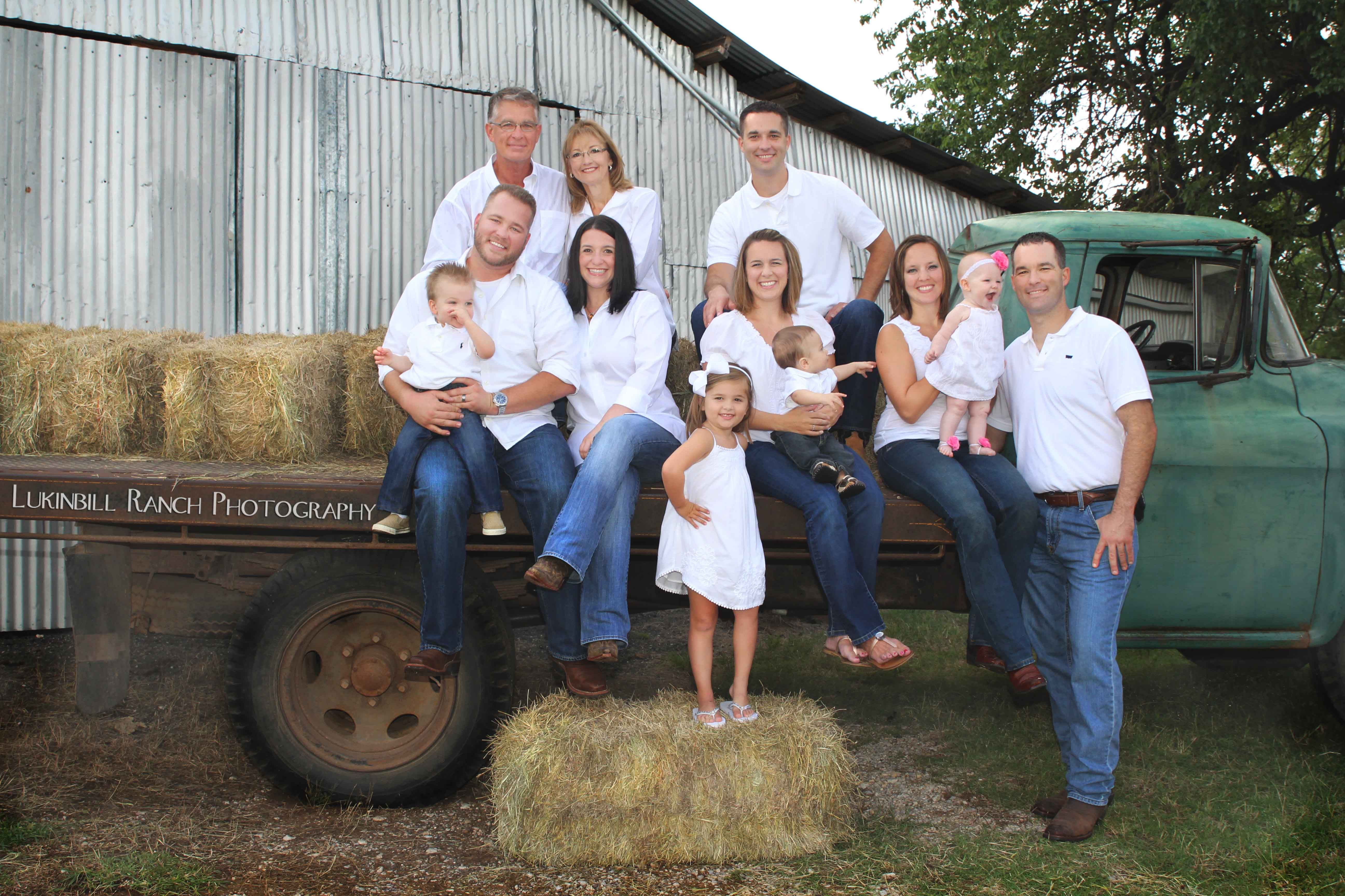 Family portraits are enhanced by adding some personal history or style, like this old farm truck.