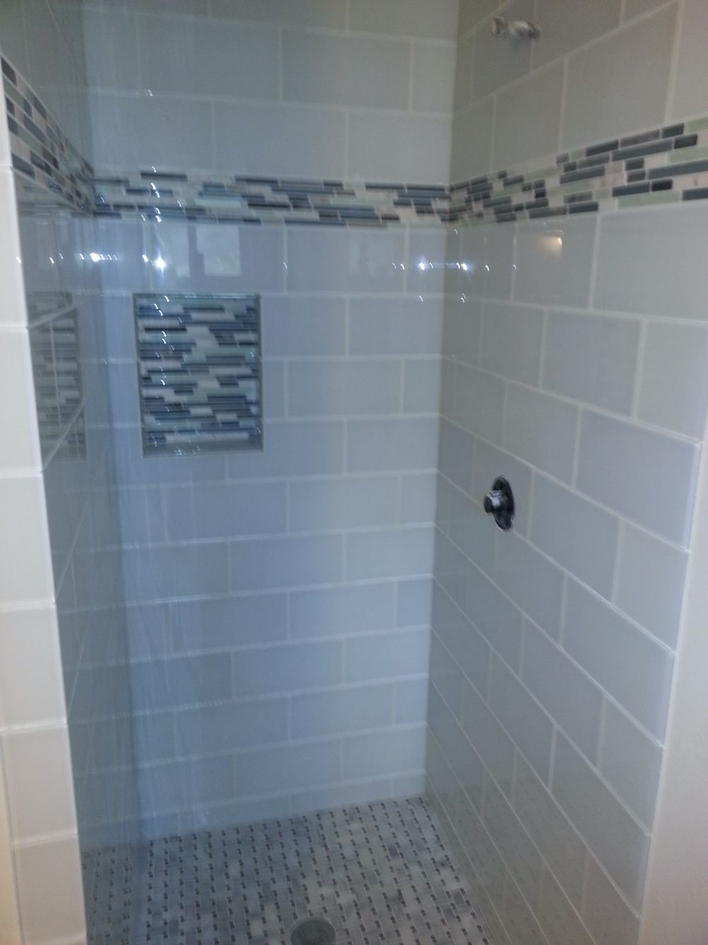 Glass tile shower with recessed shampoo shelf ATX Tile installed ...
