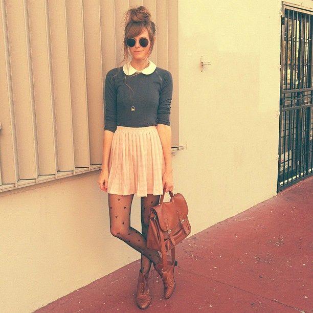 Collar sweater, pleated skirt, heart tights + satchel + high messy bun that…