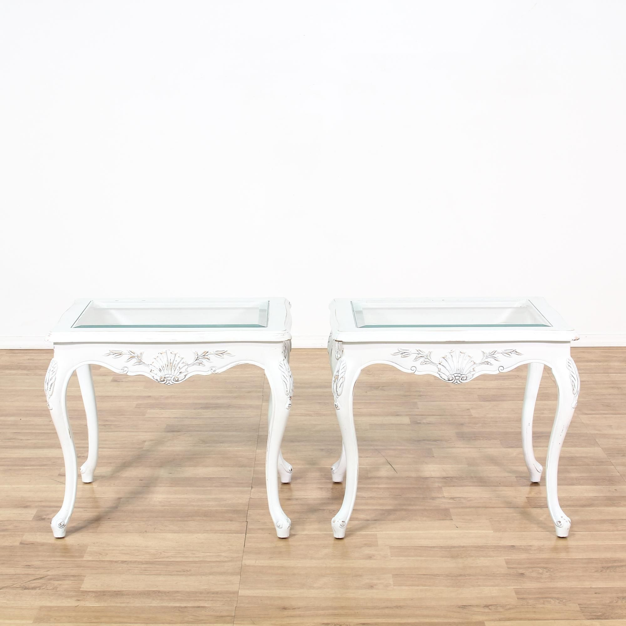 This pair of french provincial end tables are featured in a solid