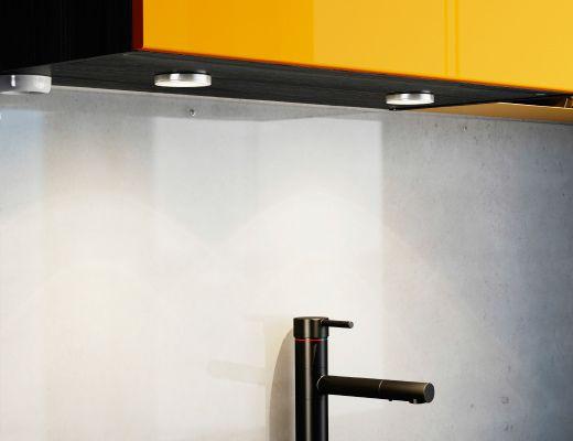 Ikea Küchenunterschrank ~ Close up of downlighters underneath an ikea kitchen cabinet