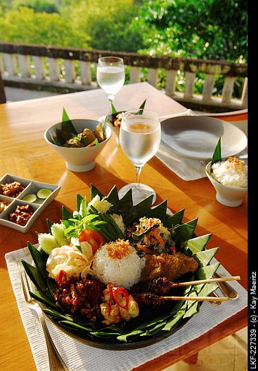 nasi campur, indonese breakfast on the terrace of amanusa resort