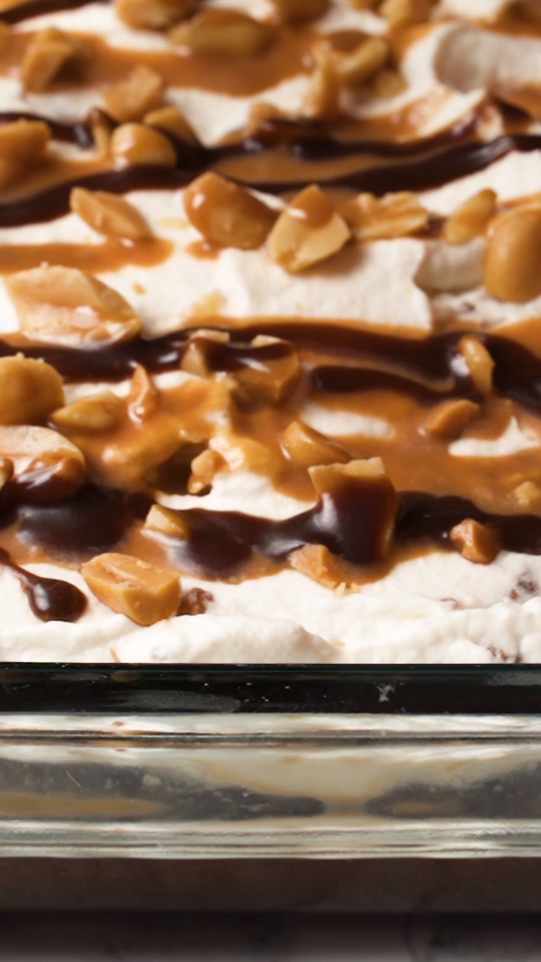 Poke Cake Recipe Snickers Poke Cake Recipe - chocolate cake, caramel, whipped cream, peanuts and chocolate sauce - OMG! There is NEVER any left! People go nuts over this cake!!Snickers Poke Cake Recipe - chocolate cake, caramel, whipped cream, peanuts and chocolate sauce - OMG! There is NEVER any left! People go nuts over this cake!!