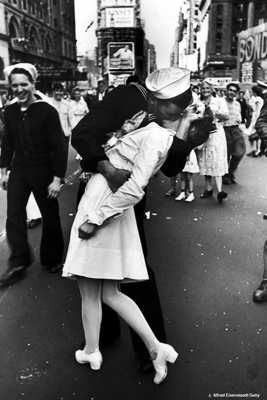 This photograph was taken on August 14, 1945, by Alfred Eisenstaedt, and published a week later in Life magazine. The photo was a spontaneous event (not posed) that occurred in Times Square when it was announced that the war on Japan had ended. Eisenstaedt was taking pictures rapidly at different events during the celebrations, and did not have an opportunity to get the names of the two individuals.