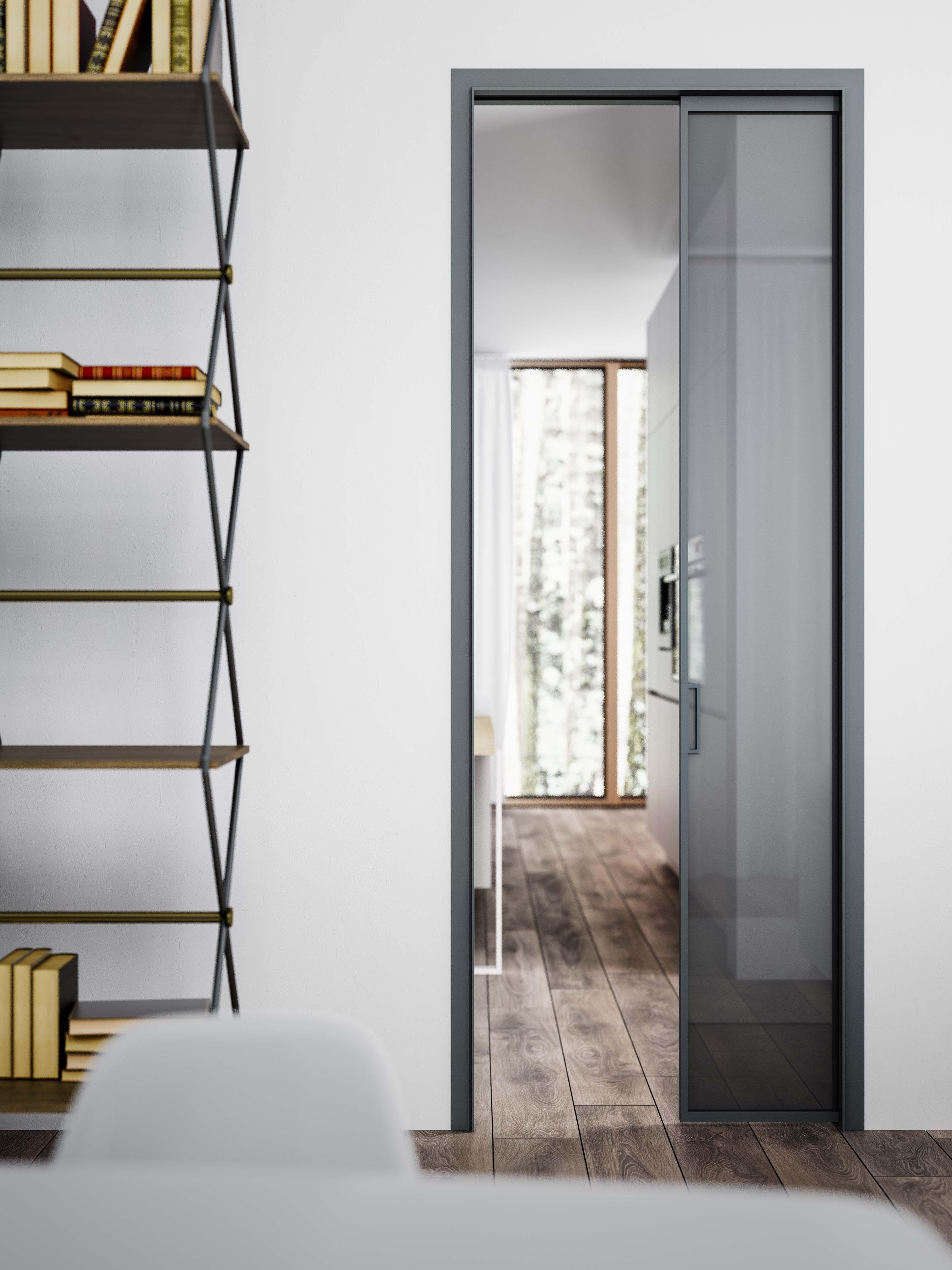 Porta scorrevole interno muro in alluminio grigio ferro e vetro ...
