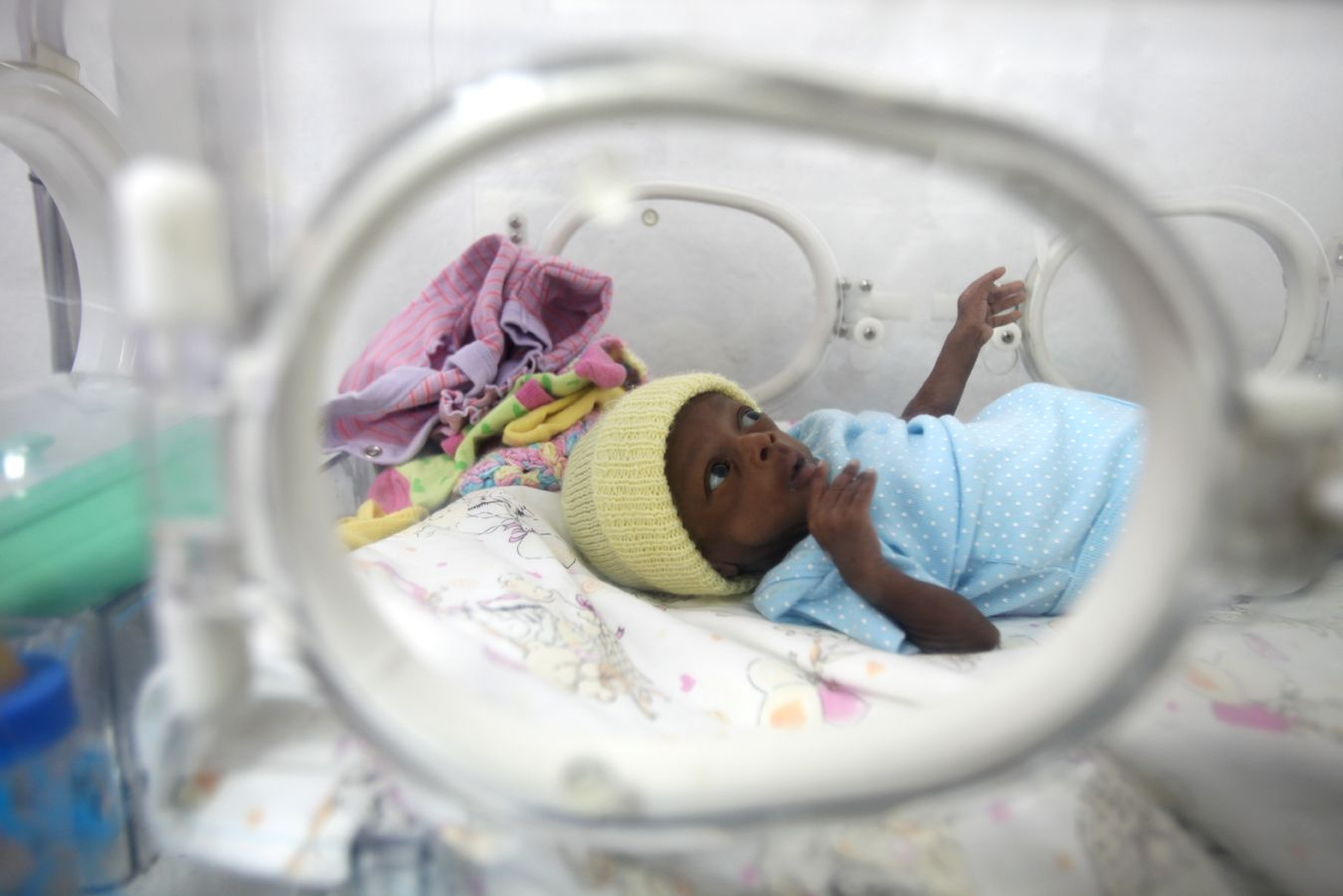 March 13 A premature baby rests in an incubator within