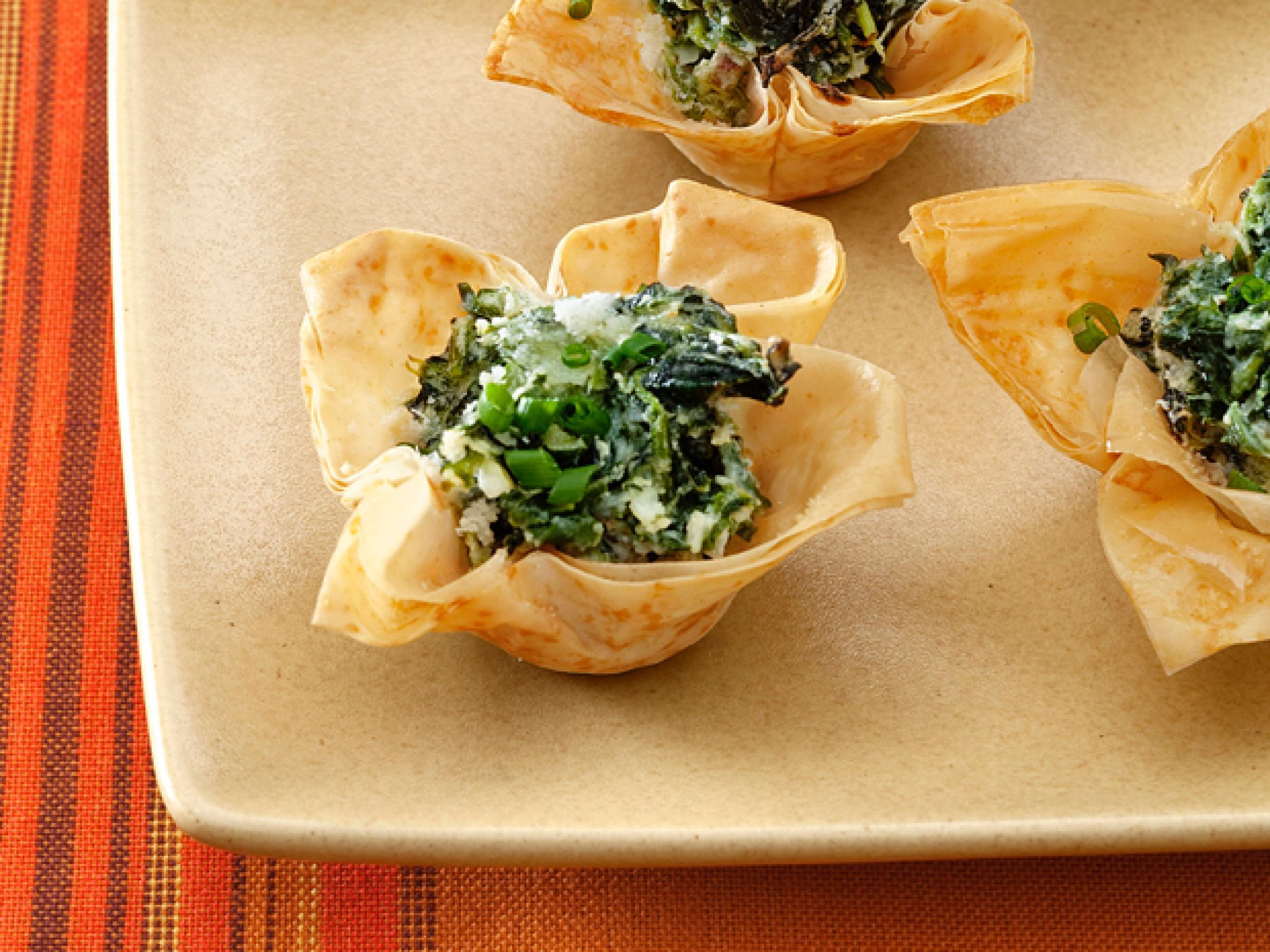 Easy and elegant holiday appetizer recipes food network goat spinach and goat cheese tartlets learn how to make easy yet elegant holiday appetizers for your holiday party this season from food network forumfinder Gallery