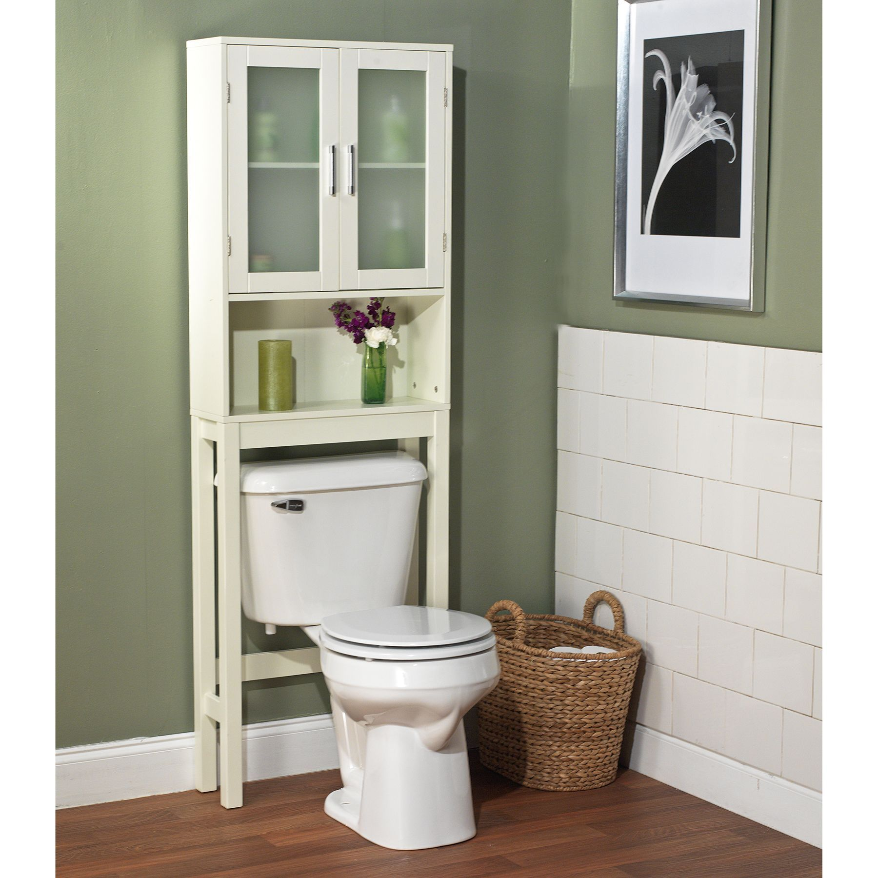 Place this white bathroom space saver around the toilet and add
