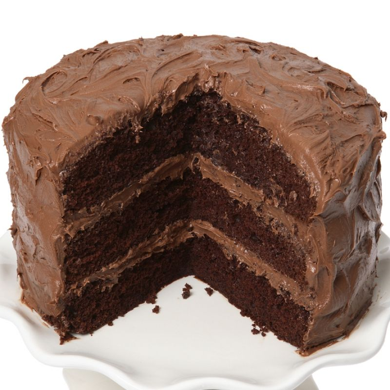 This triple chocolate cake recipe is topped with a thick ...