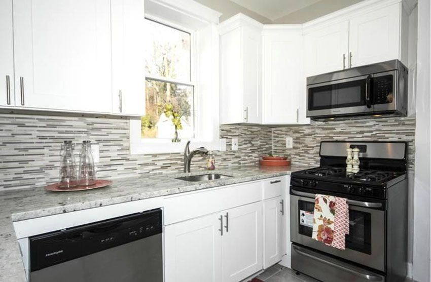 Small Kitchen With White Cabinets And Glass Mosaic Tile Backsplash Small White Kitchens Small Kitchen Backsplash Kitchen Design Small
