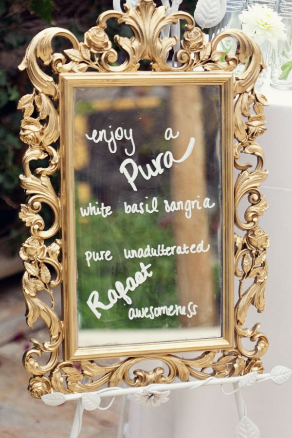 a drink menu written on a gold mirror.   Photography by http://shewanders.com, Event Design by http://sittinginatreeevents.com
