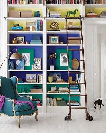 color blocked bookshelves + turquoise wingback | martha stewart living