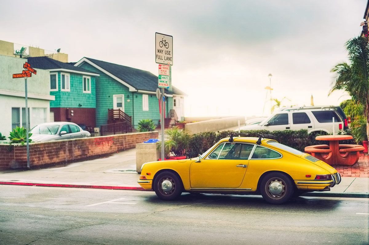 Classic Yellow Porsche Next To The Pacific Ocean In Hermosa Beach California A Very