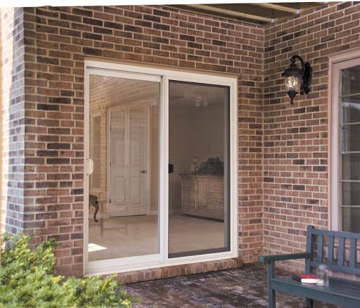 Sliding Patio Doors On A Beautiful Brick Home Creates A Nice Outdoor Living Space Upvc French Doors French Doors Modern Patio Doors