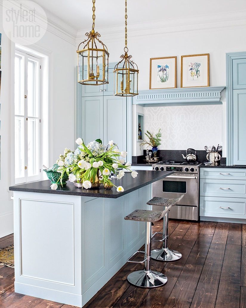 Vintage lantern-style pendant lights add heft to the pale blue ...