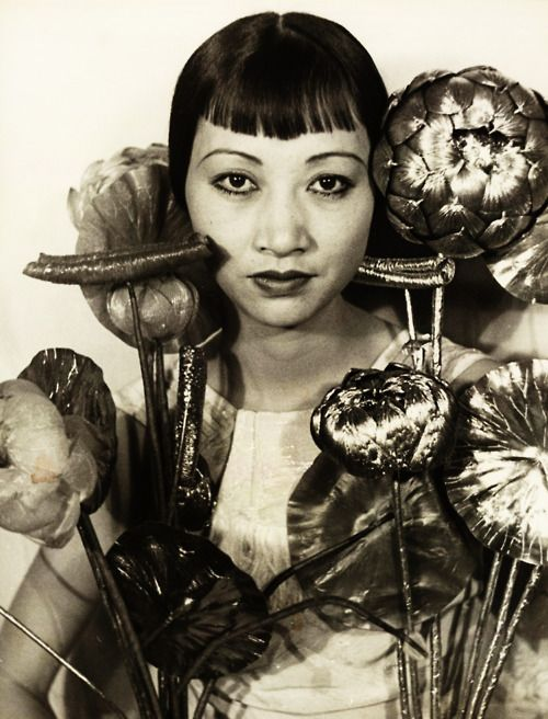 cloaked with metal lotus flowers - Anna May Wong by Carl Van Vechten