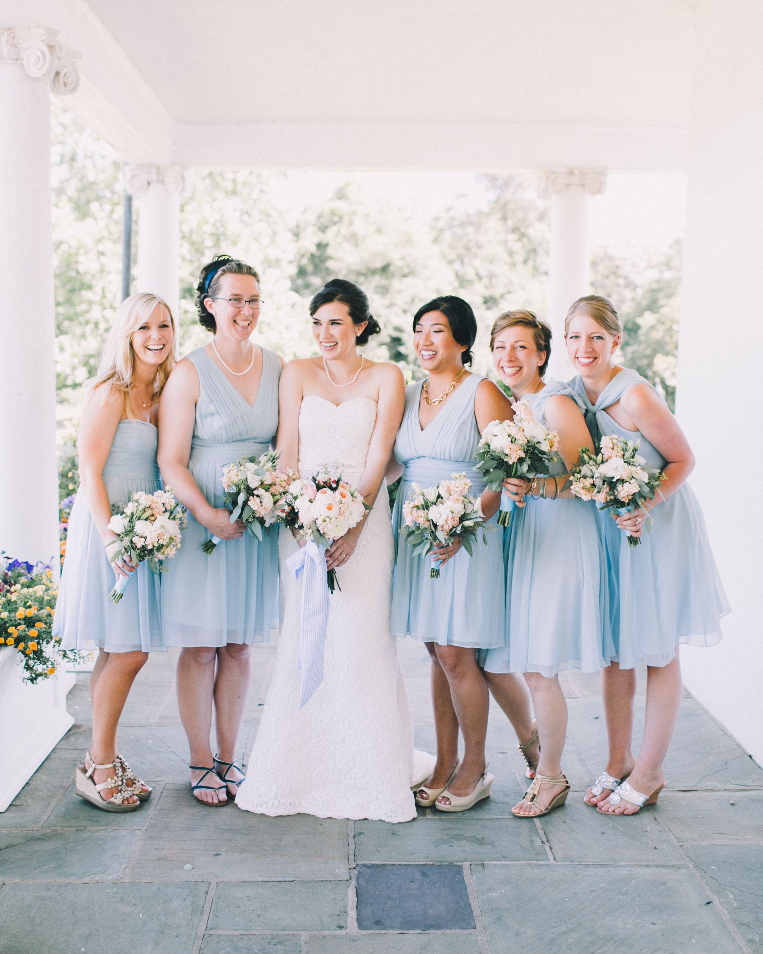 Bridesmaids in knee length powder blue dresses at summer wedding bridesmaids in knee length powder blue dresses at summer wedding ombrellifo Gallery