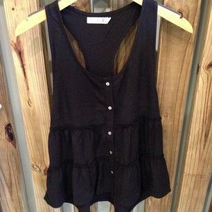 Black tank with feminine ruffled layers and white buttons.     splurgesboutique (Splurges Boutique) - Instagram Photo Feed on the Web - Gramfeed
