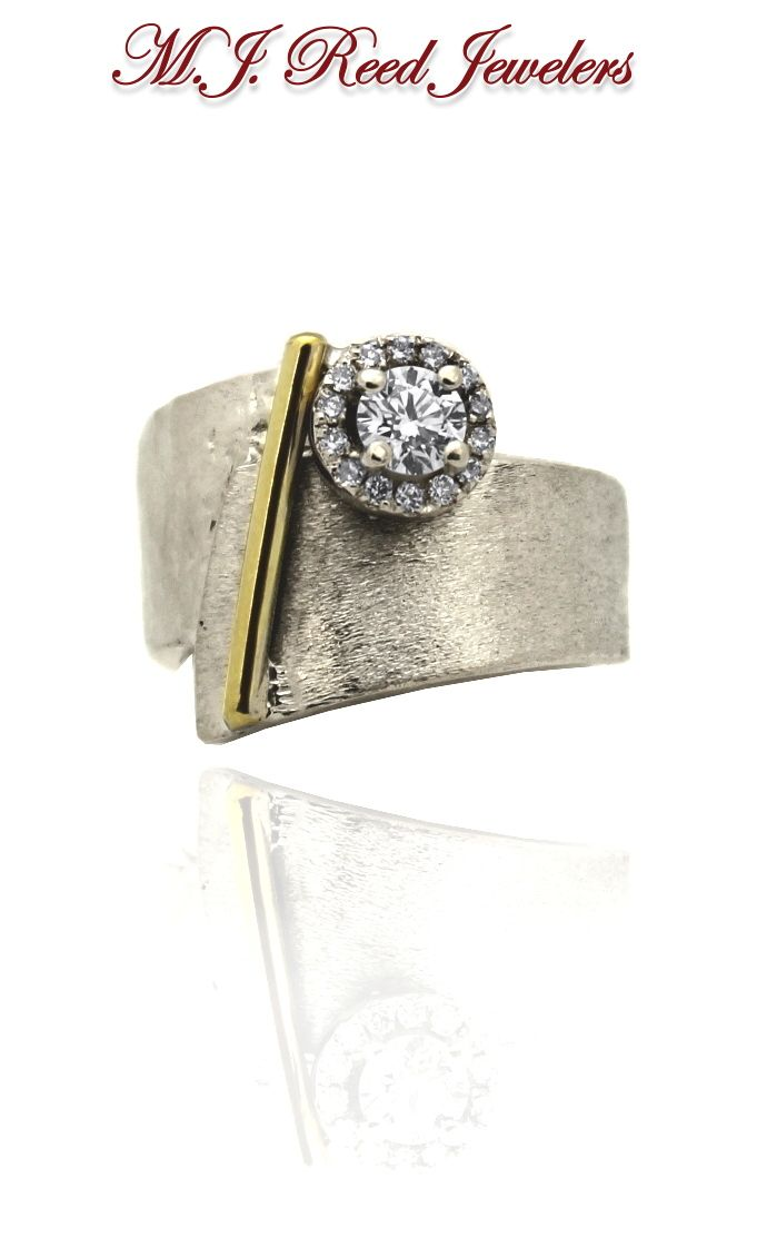 A one of a kind recently custom designed ring. The white gold ring combines multiple textures and a single line of yellow gold for a really unique look - set off by Diamonds!