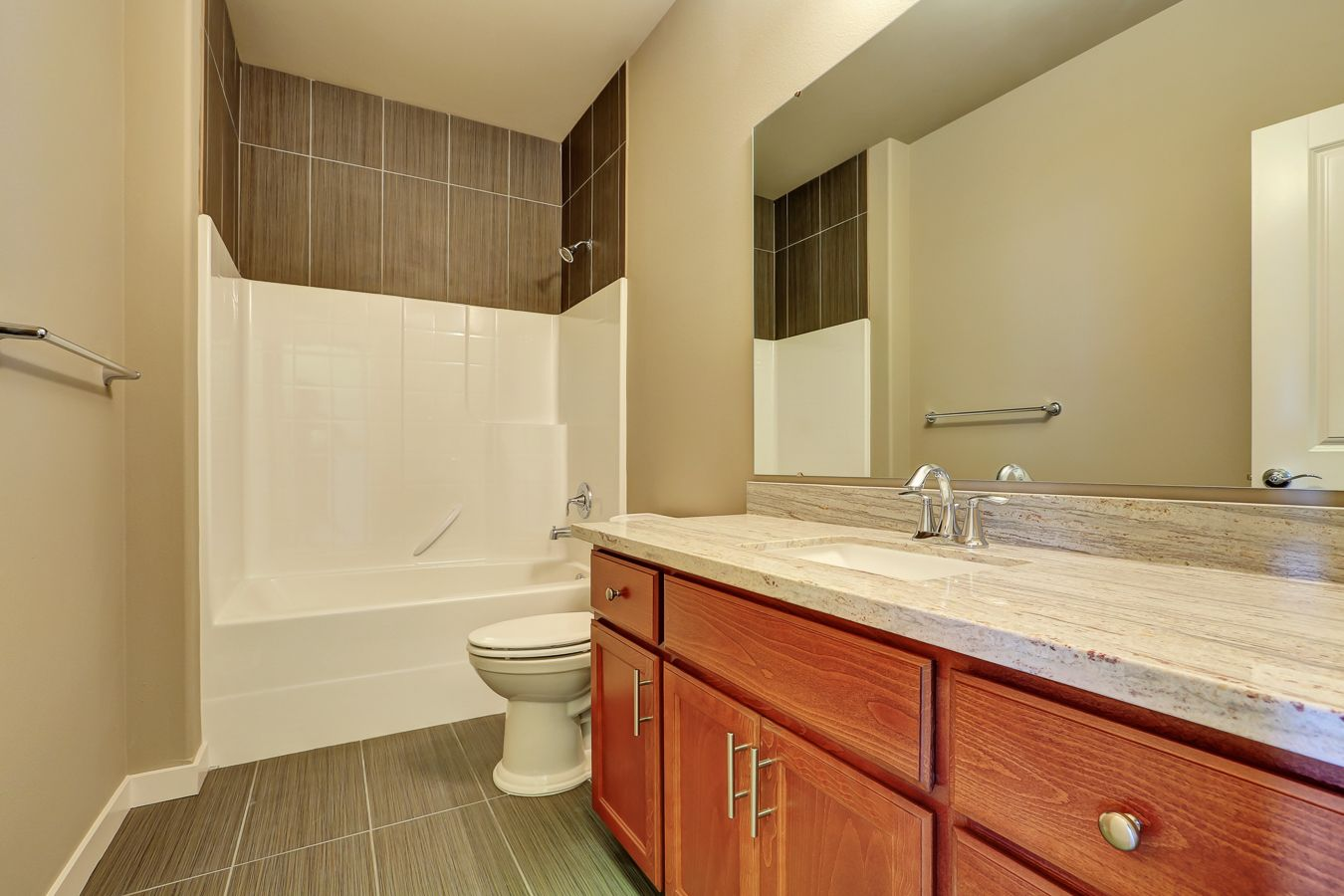 Fiberglass tub shower with tile surround above matching the floor ...