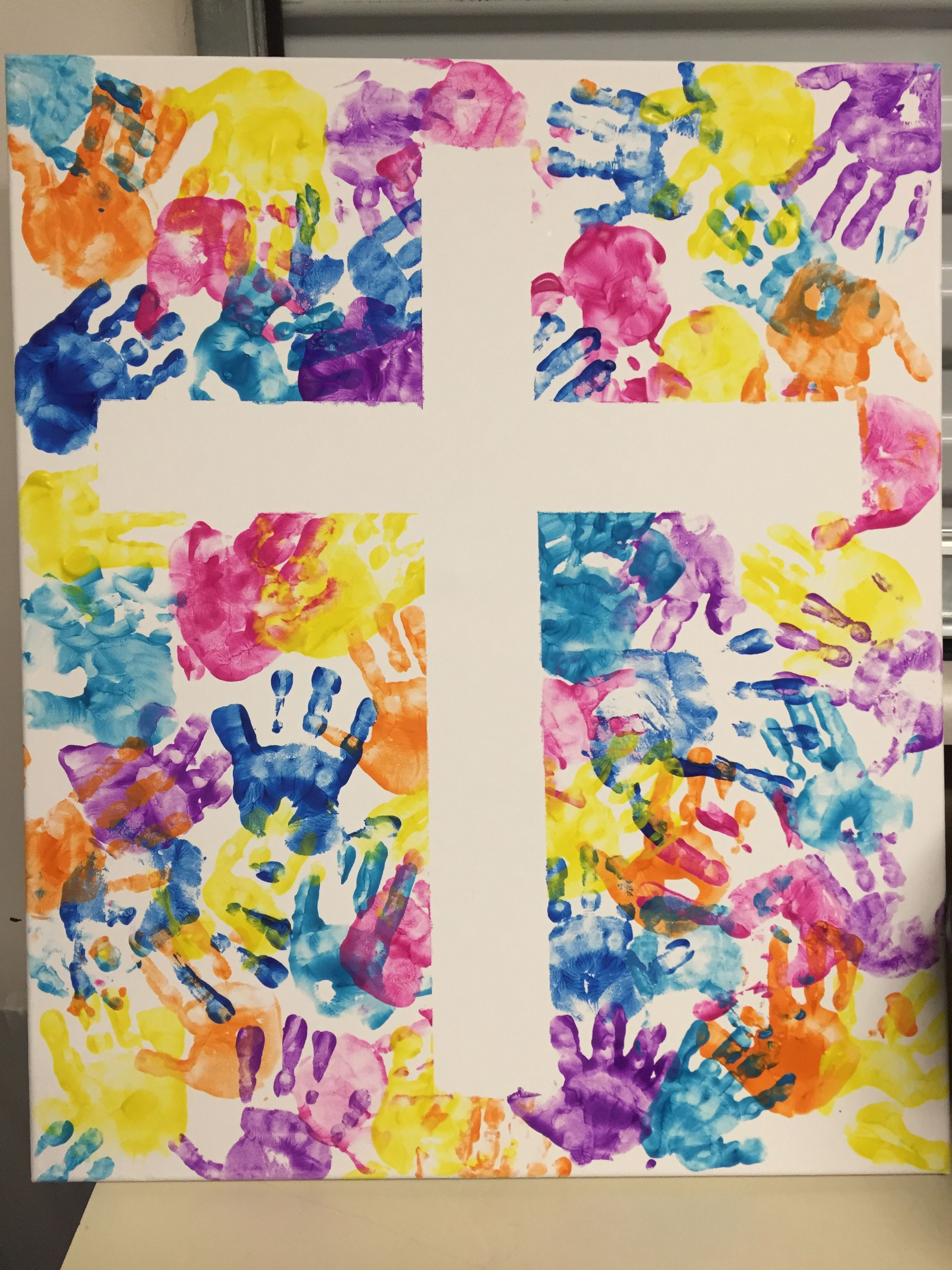 Handprint Cross Made By Nursery Kids Age 0 5 Used Blue Painters Tape To Make The Cross On A Large Kids Canvas Art Large Canvas Art Diy Cross Canvas Paintings