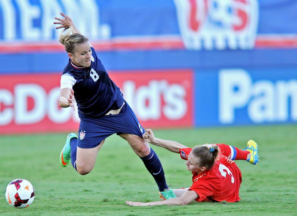 Russian defender Valentina Orlova pulls Amy Rodriguez down