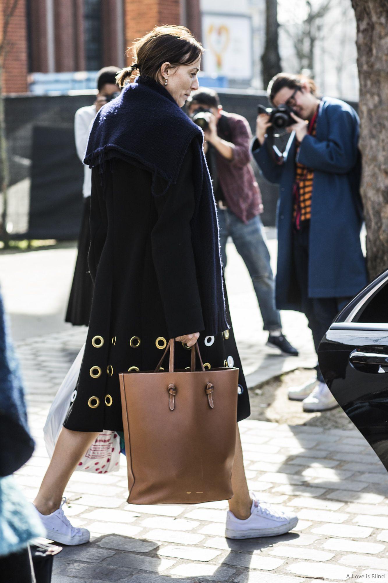 Laid back cool in kicks, Celine tote, mini ponytail.
