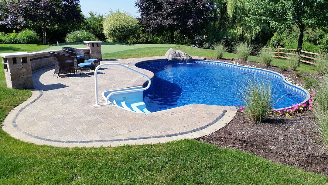 Radiant Semi-Inground Freeform with walk-in steps and water feature ...