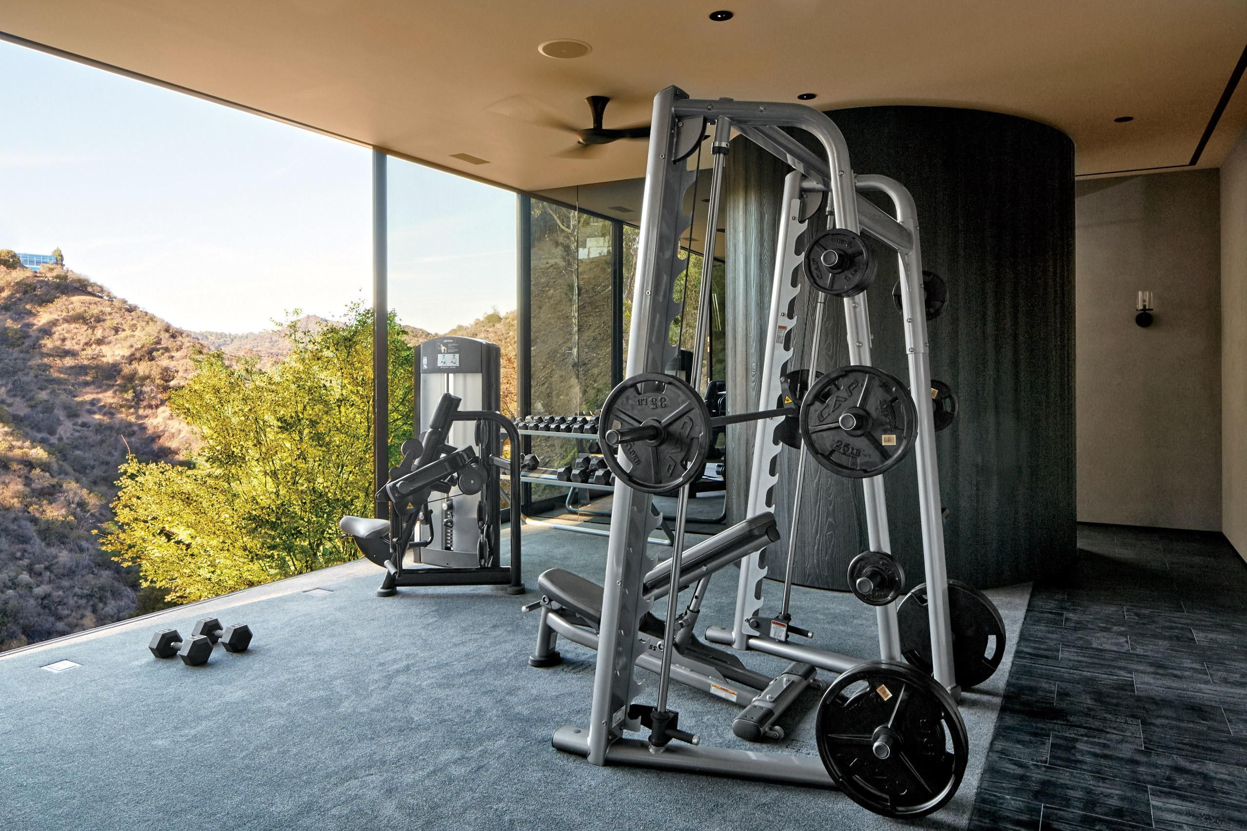 10 Home Gyms That Will Inspire You To Sweat Home Gym Design At Home Gym Celebrity Houses