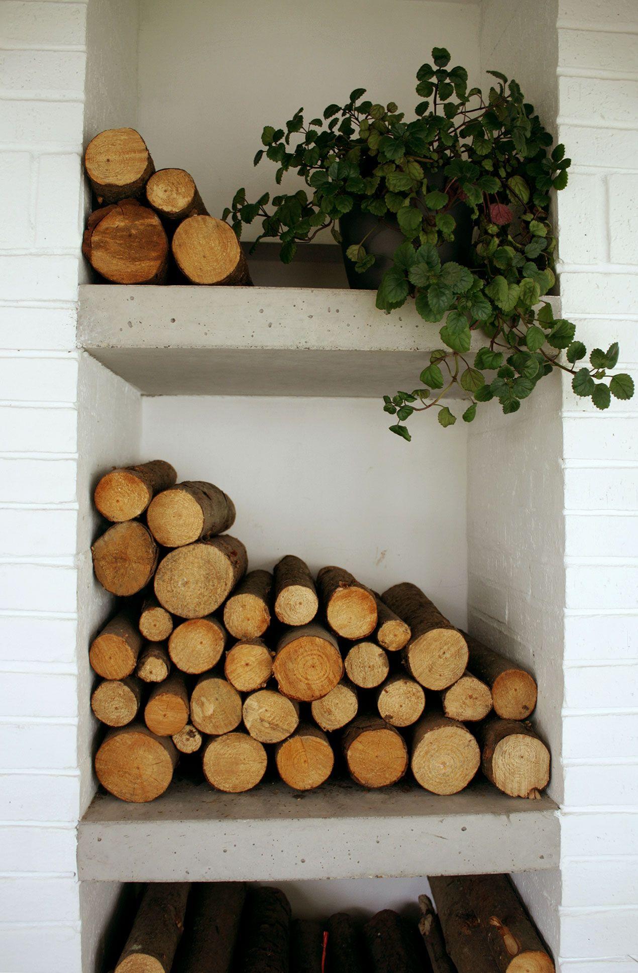 White Painted Brick. Concrete Shelves. Fireplace Log Storage ...