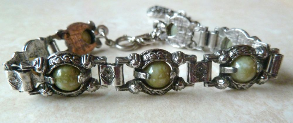 A Vintage adjustable length Celtic style panel bracelet The bracelet is formed from silver tone metal with seven panels Each panel has a centrally