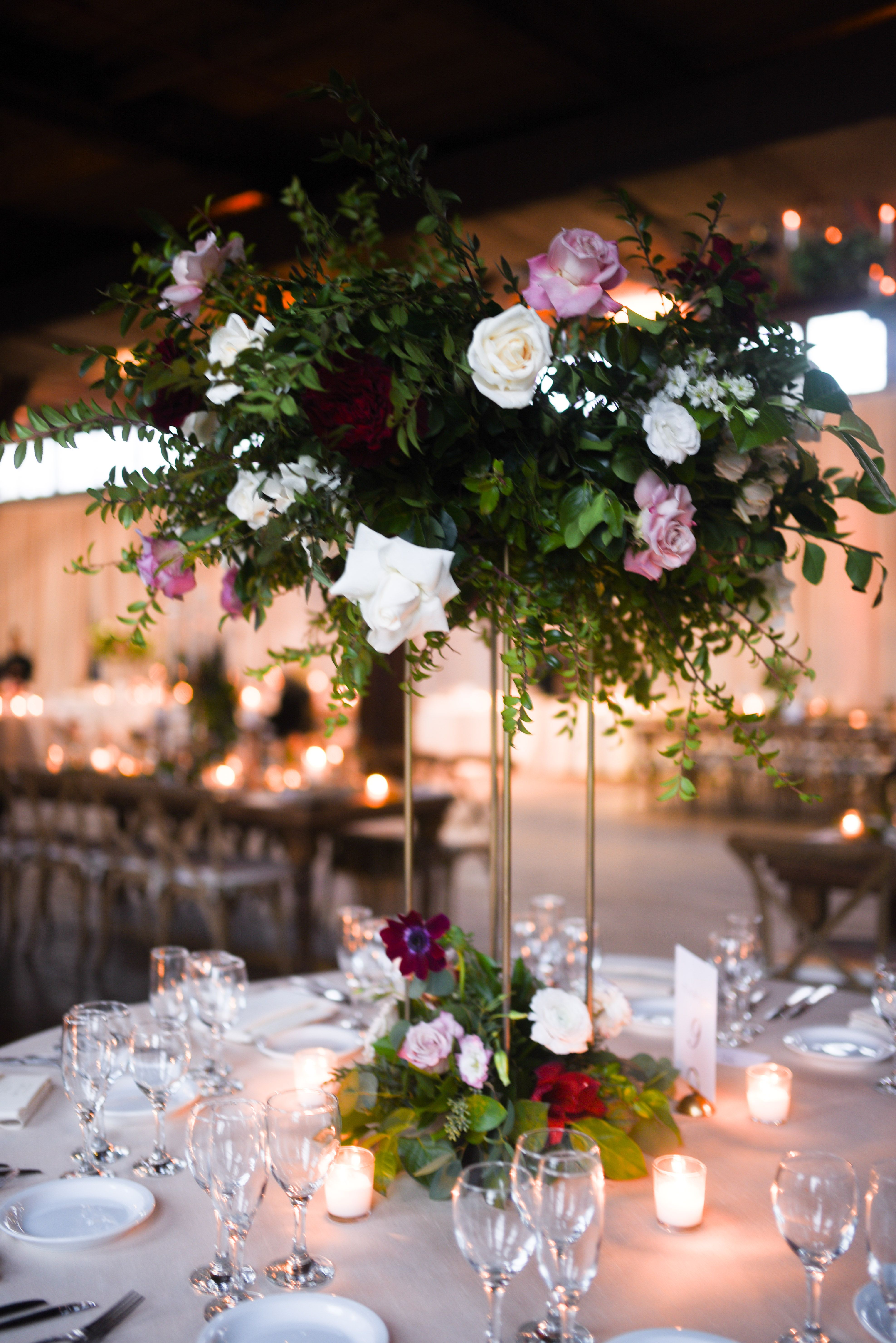 Candelabras Lanterns Pillar Candles And Lots Of Gorgeous Blooms Tall Centerpieces Chalice Centerpieces Hangi Tall Centerpieces Pillar Candles Centerpieces