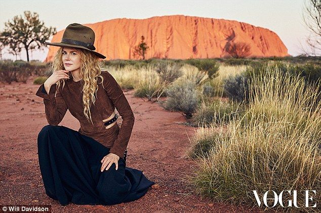 High fashion! The 48-year-old donned cut out designer ensemble as she knelt down in front of her iconic Australian backdrop of Uluru