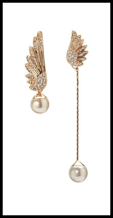 Mismatch wing earrings by Point Ashley jewelry.