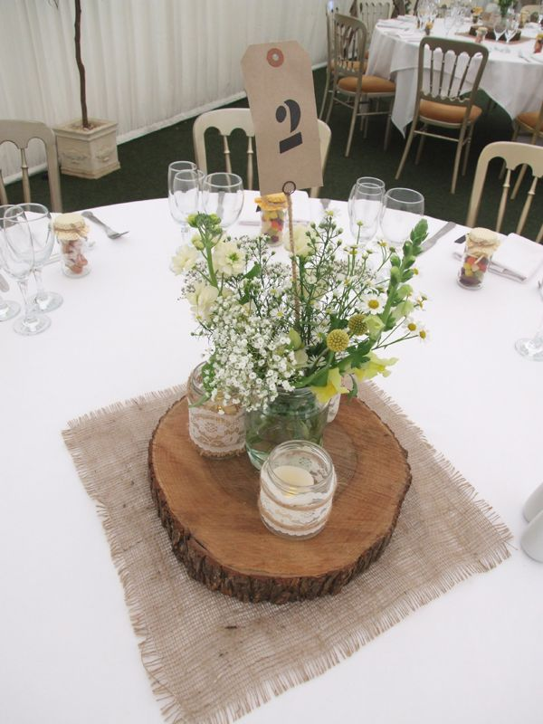 Rustic marquee wedding sweetpea and ivy log slice centrepiece jam rustic marquee wedding sweetpea and ivy log slice centrepiece jam jars lace hessian junglespirit Image collections