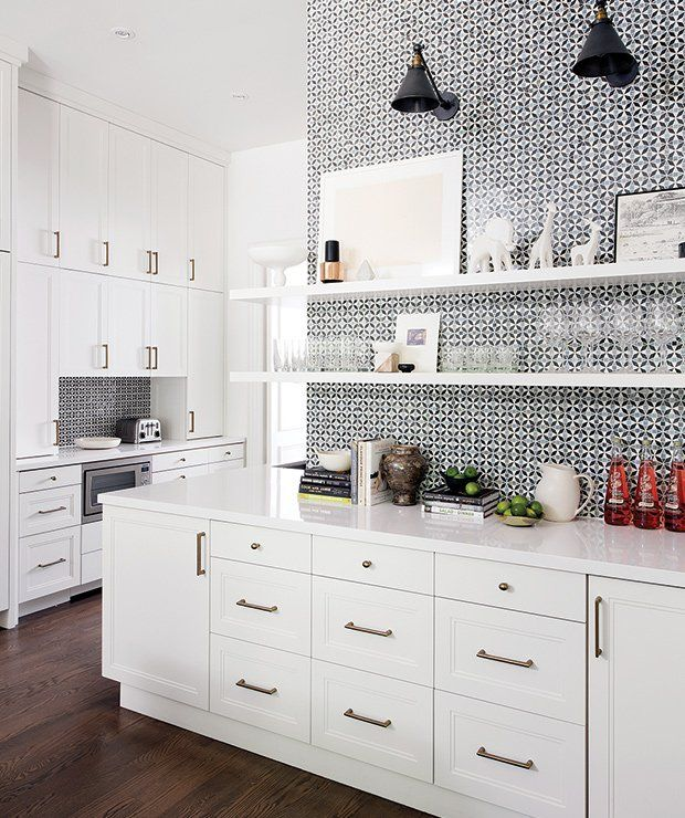 white cabinets and a tiled wall