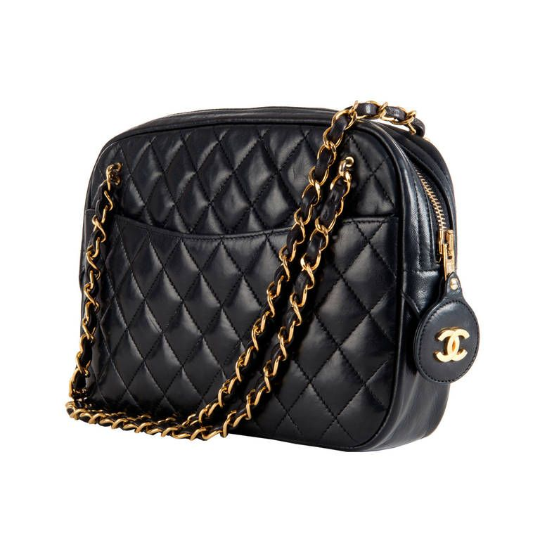 bcf3fe21455c A Classic Chanel 25cm 'Camera' Bag in Navy Quilted Lambskin | From a  collection