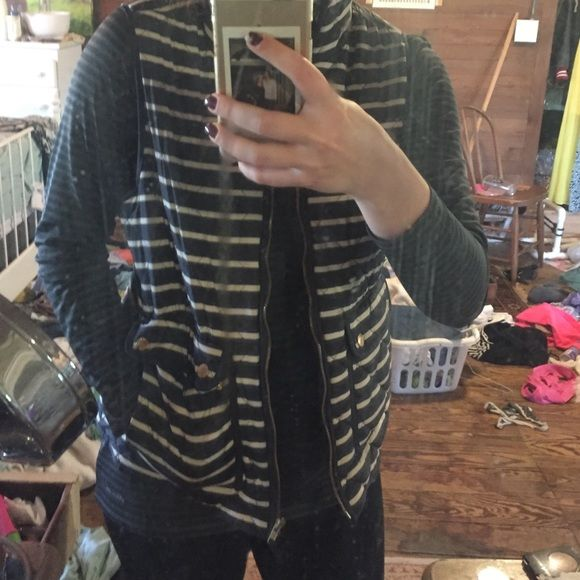 British Khaki Blue and White Striped Vest!! I love this vest!! It has four real pockets, the two in front and two on the side as you can see in the first picture (I have my hand in it) VERY little use, great deal!! Bought originally for 40, it was marked down from 60!! British Khaki Jackets & Coats Vests