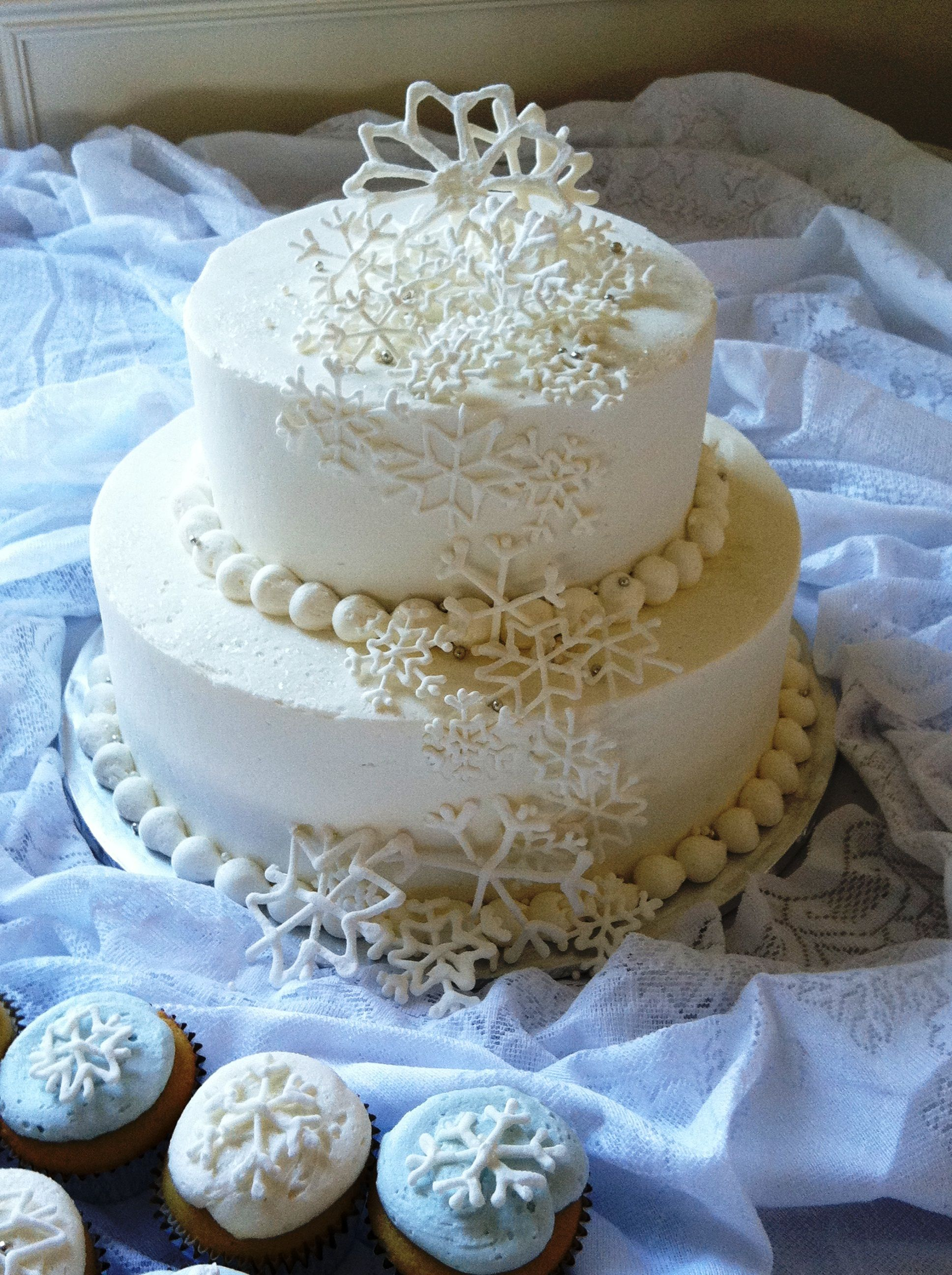 A winter themed wedding cake I made. 150 snowflake cupcakes ...