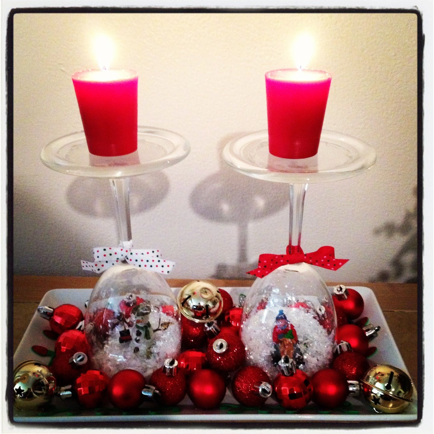 Snow globe wine glasses with candles and mini ornaments. Makes a great centerpiece for a small table during the holidays. :)