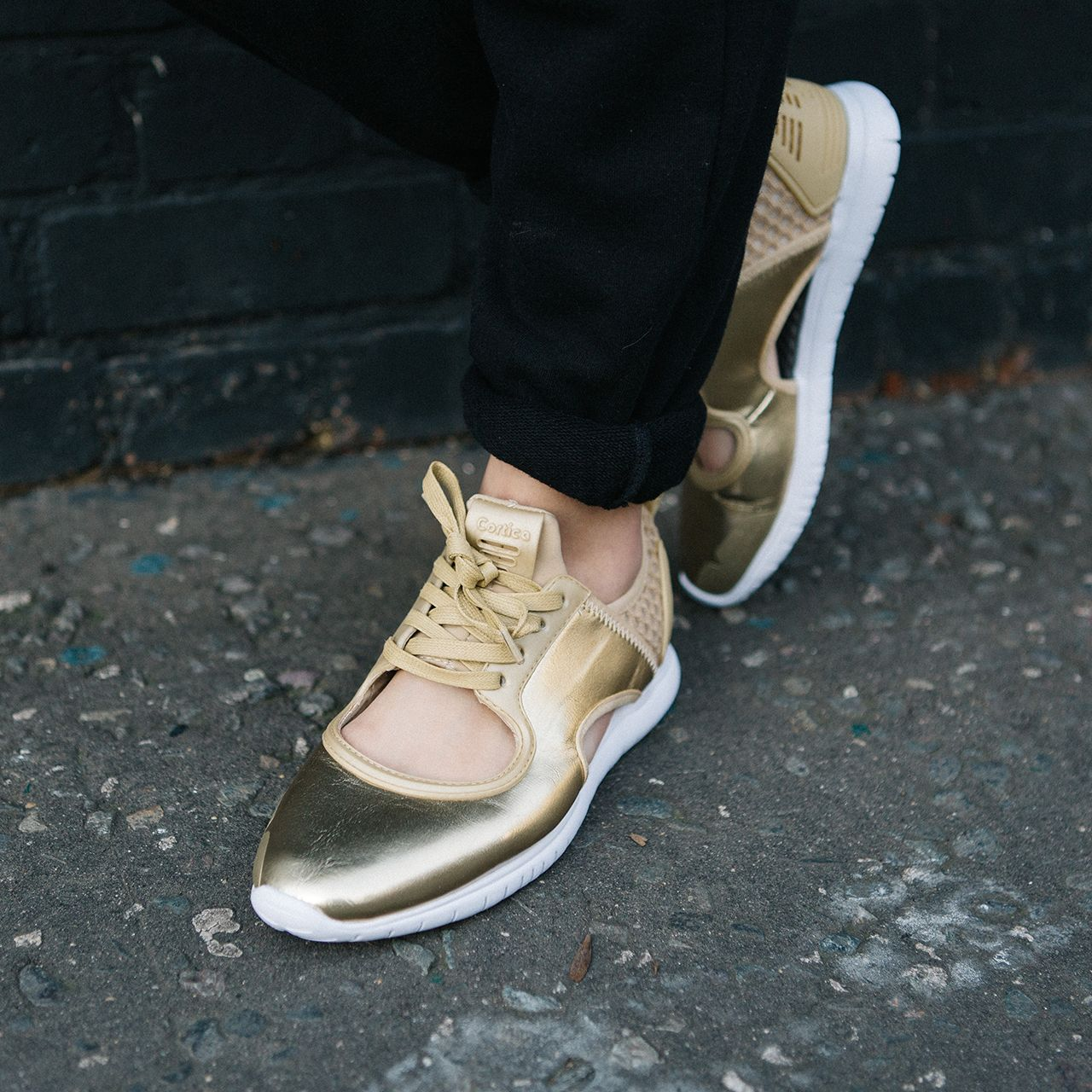 d80b423cd68 The Women s Cortica Epic Runner Trainer in Gold Foil. More styles  available. Sneaker Outfits