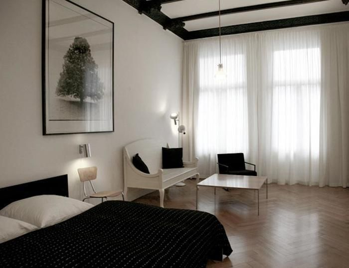 simple black white floor to ceiling drapes parquet flooring
