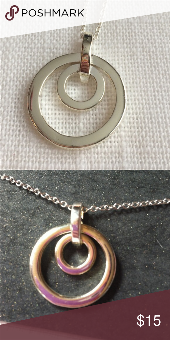 """BRAND NEW Double Circle Silver Plate Necklace Brand new with tags. Retail $50. Pendant measures 1"""" in diameter. Chain is 18."""" 📦Bundle and save💰5%! ❌Price is firm unless bundled❌ Jewelry Necklaces"""